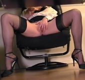High heeled office lass in black stockings spreading under the table and