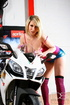 Striped pink stockings blonde undressing next to a fancy bike