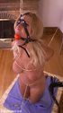 Ballgagged blonde slave tortured with ropes and clothespins