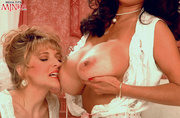 wavy-haired buxom milf with