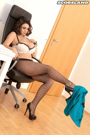 fishnets-wearing wavy-haired brunette shows