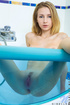 Kinky blue get-up blonde shows her pussy in a hot tub