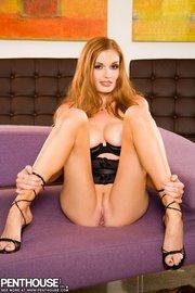 alluring redhead black lingerie