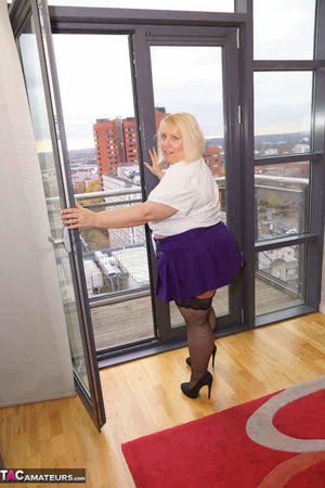 High heeled bbw in black stockings and purple miniskirt sheds blue bra and exposing her pierced snatch on the balcony - XXXonXXX - Pic 2