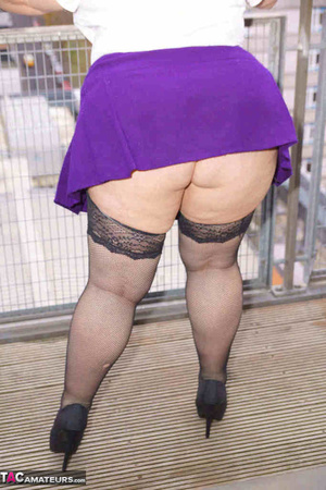 High heeled bbw in black stockings and purple miniskirt sheds blue bra and exposing her pierced snatch on the balcony - XXXonXXX - Pic 4