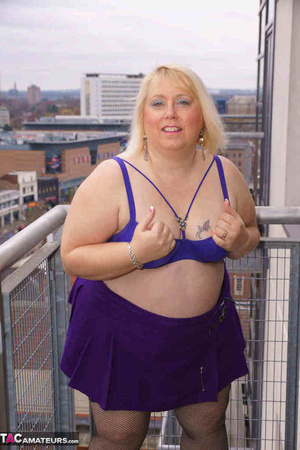 High heeled bbw in black stockings and purple miniskirt sheds blue bra and exposing her pierced snatch on the balcony - XXXonXXX - Pic 9