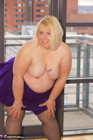 High heeled bbw in black stockings and purple miniskirt sheds blue bra and exposing her pierced snatch on the balcony - XXXonXXX - Pic 20