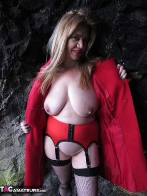 Mature brunette in fishnet stockings and rubber boots opens her red coat and showing her huge tits outdoors - XXXonXXX - Pic 5