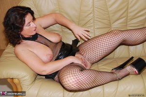 Busty brunette in fishnet bodystockings and high heels took off leather miniskirt and showing her shaved fuck holes - XXXonXXX - Pic 1