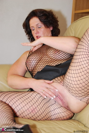 Busty brunette in fishnet bodystockings and high heels took off leather miniskirt and showing her shaved fuck holes - XXXonXXX - Pic 4