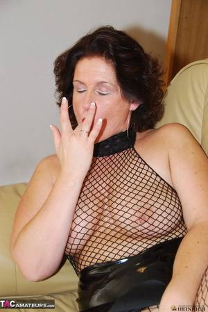 Busty brunette in fishnet bodystockings and high heels took off leather miniskirt and showing her shaved fuck holes - XXXonXXX - Pic 5