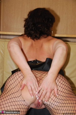 Busty brunette in fishnet bodystockings and high heels took off leather miniskirt and showing her shaved fuck holes - XXXonXXX - Pic 7