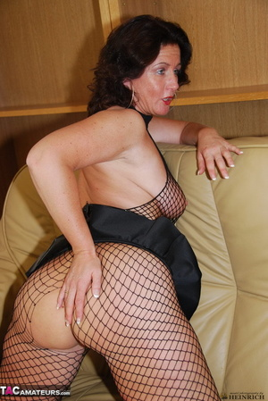 Busty brunette in fishnet bodystockings and high heels took off leather miniskirt and showing her shaved fuck holes - XXXonXXX - Pic 9