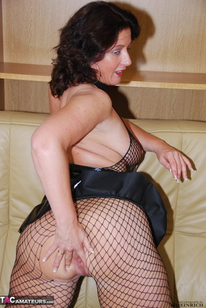 Busty brunette in fishnet bodystockings and high heels took off leather miniskirt and showing her shaved fuck holes - XXXonXXX - Pic 10