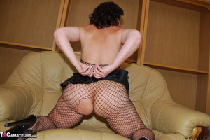 Busty brunette in fishnet bodystockings and high heels took off leather miniskirt and showing her shaved fuck holes - XXXonXXX - Pic 11