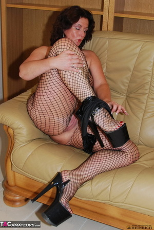 Busty brunette in fishnet bodystockings and high heels took off leather miniskirt and showing her shaved fuck holes - XXXonXXX - Pic 13