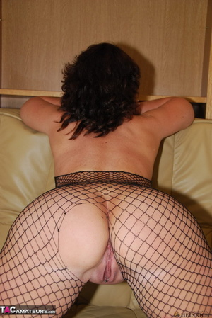Busty brunette in fishnet bodystockings and high heels took off leather miniskirt and showing her shaved fuck holes - XXXonXXX - Pic 15