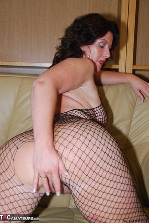 Busty brunette in fishnet bodystockings and high heels took off leather miniskirt and showing her shaved fuck holes - XXXonXXX - Pic 16