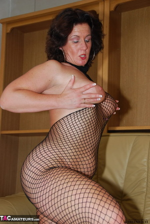 Busty brunette in fishnet bodystockings and high heels took off leather miniskirt and showing her shaved fuck holes - XXXonXXX - Pic 20