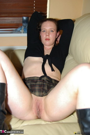 Small tits redhead in leather boots slowly taking off black top and plaid miniskirt just to show her shaved fuck hole - XXXonXXX - Pic 4