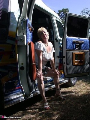 Mature blonde in white top and jeans miniskirt peeing outdoors before exposing her huge breast on the beach - XXXonXXX - Pic 1