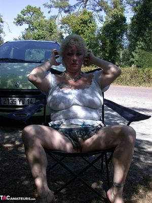Mature blonde in white top and jeans miniskirt peeing outdoors before exposing her huge breast on the beach - XXXonXXX - Pic 2