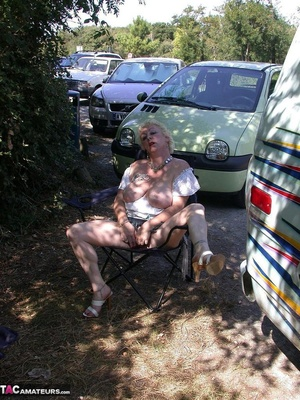 Mature blonde in white top and jeans miniskirt peeing outdoors before exposing her huge breast on the beach - XXXonXXX - Pic 4