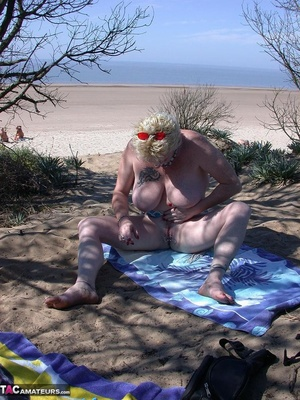 Mature blonde in white top and jeans miniskirt peeing outdoors before exposing her huge breast on the beach - XXXonXXX - Pic 12