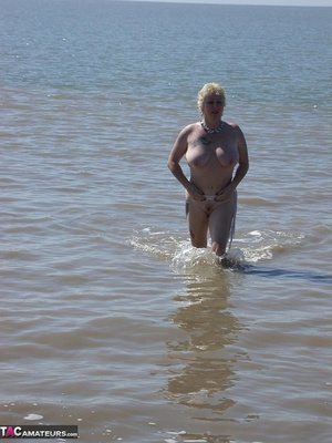 Mature blonde in white top and jeans miniskirt peeing outdoors before exposing her huge breast on the beach - XXXonXXX - Pic 19