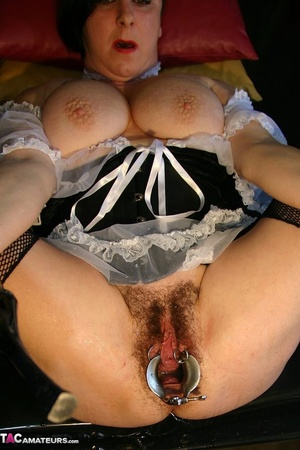 Chubby brunette in fishnet stockings and high heels toying her hairy cunt with gynecological tool before peeing in the bucket - XXXonXXX - Pic 4