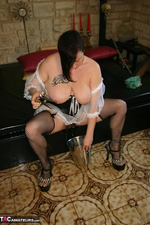 Chubby brunette in fishnet stockings and high heels toying her hairy cunt with gynecological tool before peeing in the bucket - XXXonXXX - Pic 17