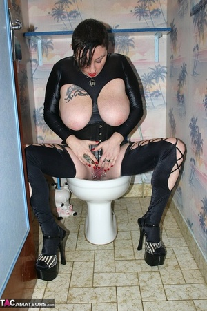Smoking brunette with red lips and huge breast peeing on the toilet bowl and showing her pierced snatch - XXXonXXX - Pic 4