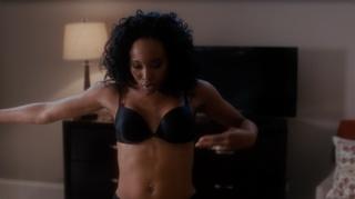 ebony stripper slowly undresses