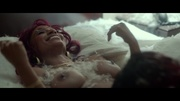 redhead ebony lying topless