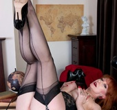 Big-boobed redhead cougar in black lace lingerie