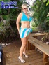 Amazing blonde with huge pierced tits wearing sunglasses and light blue