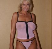 Lucious blonde wearing sheer pink top and thong gets her legs carried