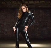 Small-tit goddess in black leather shows herself naked