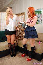 redhead lesbian skirt dildo-fucking