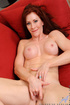 Fit redhead mature with pink tits masturbates on the red couch