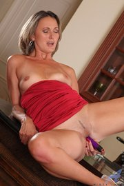 hot milf plays with