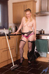 Busty blonde maid banged by a huge black stick on kitchen table