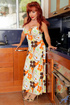 Mature redhead in floral dress gets naked and finger blasted her kitty