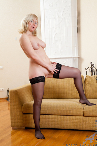 aroused cougar bends couch
