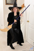 Horny granny wears witch costume and spreads her cunt by the stairs.