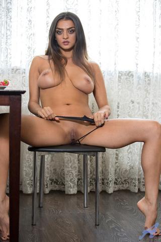 kinky indian babe sits