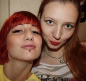 Hot redhead teen and friend bends over to show their pussies